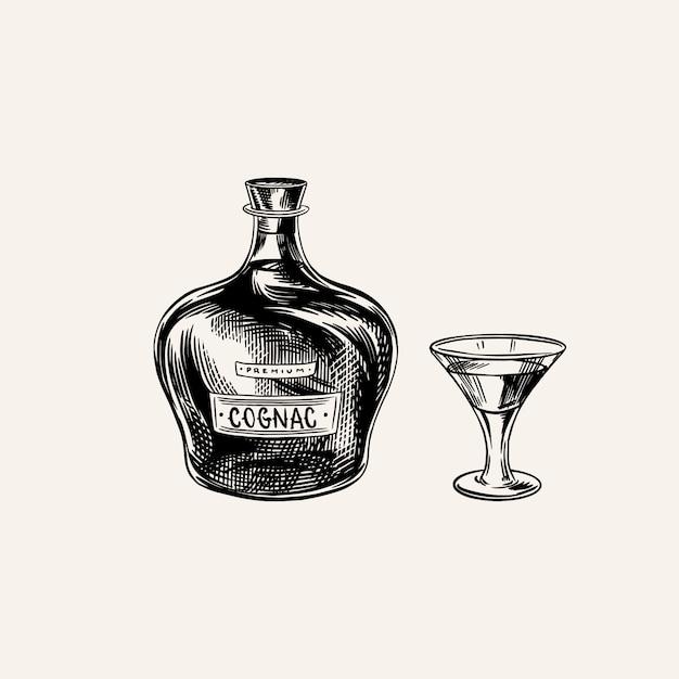 Bottiglia di cognac e calice in vetro. schizzo vintage disegnato a mano inciso. stile xilografia. illustrazione. Vettore Premium
