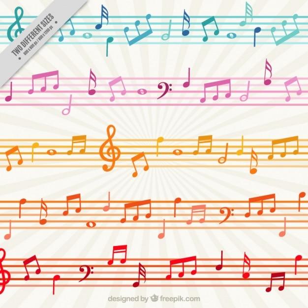 Sfondo colorato con le note musicali e bastoni Vettore Premium