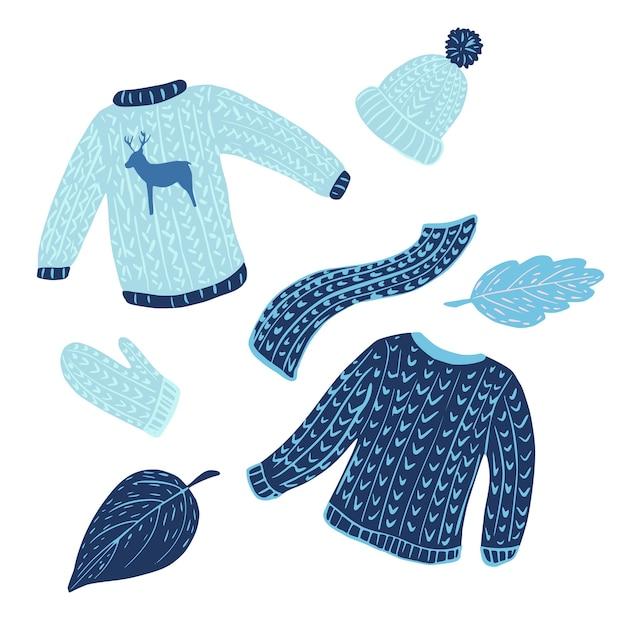 Composizione di maglioni, cappelli, sciarpe e foglie su sfondo bianco. abbigliamento stagione invernale disegnato a mano in stile doodle. Vettore Premium