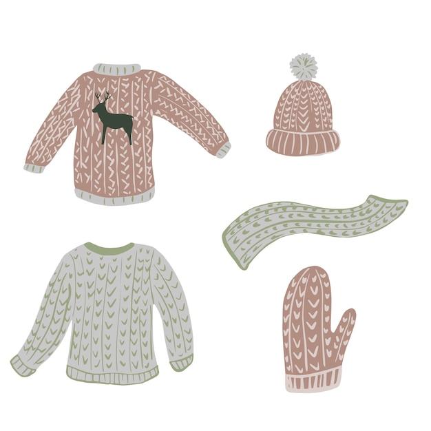 Composizione brutto maglione su sfondo bianco. abbigliamento stagione kit scandinavo da maglione, guanto, berretto, sciarpa e fogliame schizzo disegnato a mano in stile doodle. Vettore Premium