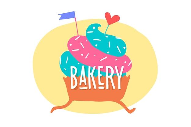 Cupcake con cuore e testo bakery. Vettore Premium