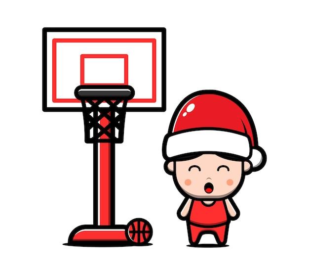 Il ragazzo sveglio che porta il cappello di santa gioca l'illustrazione del fumetto di basket concetto di natale Vettore Premium