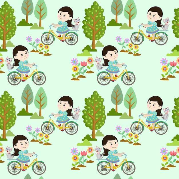 Ragazza carina in bicicletta con il gatto in giardino. Vettore Premium