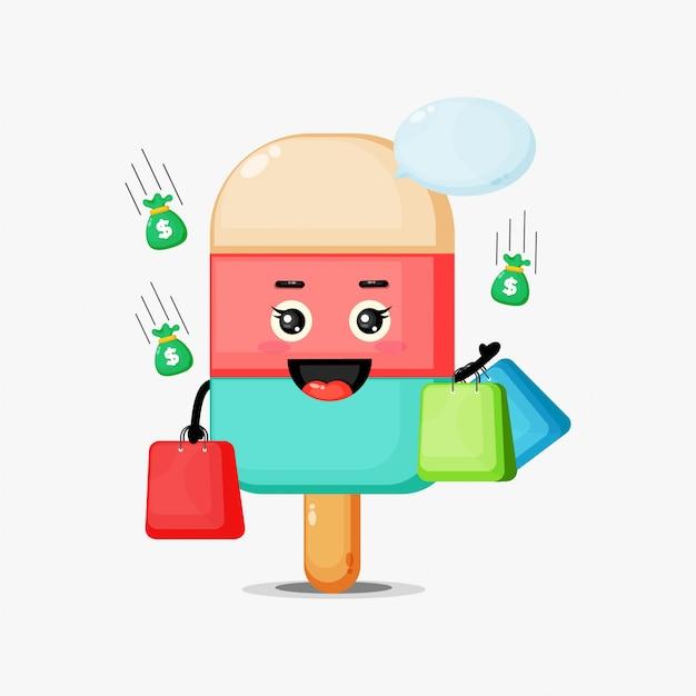 Gelato sveglio della mascotte che tiene un sacchetto della spesa Vettore Premium