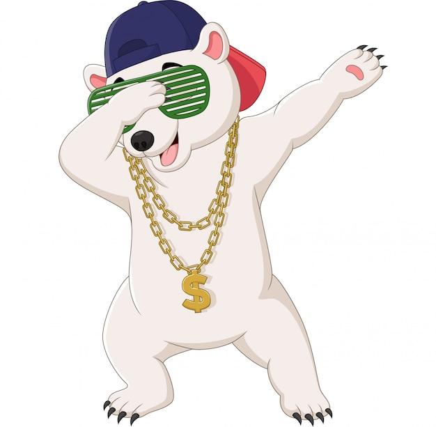 Simpatico ballo dabbing dell'orso polare con occhiali da sole, cappello e collana d'oro Vettore Premium