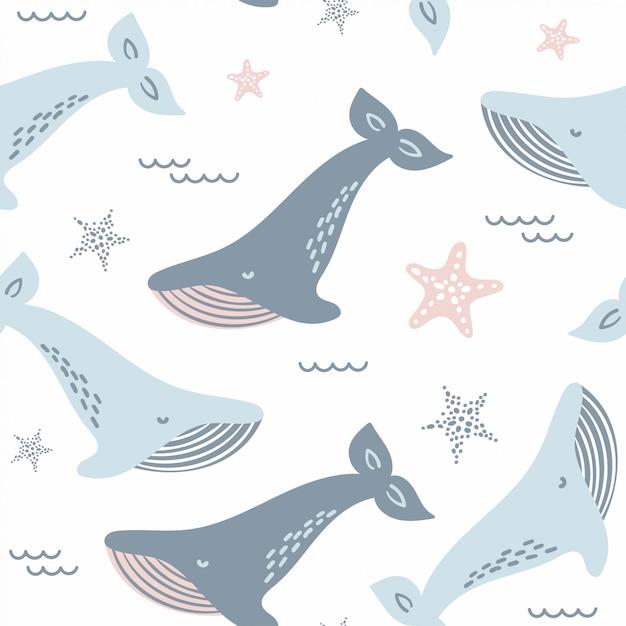Carino seamless con balene blu e stelle marine. Vettore Premium