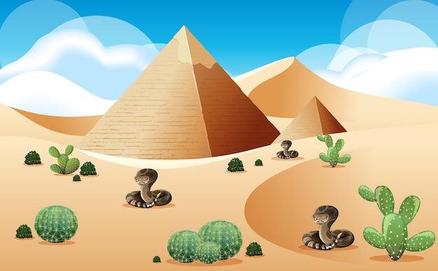 Deserto con piramide e paesaggio di serpenti a sonagli alla scena del giorno Vettore Premium