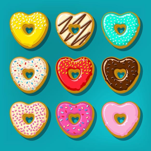 Ciambelle dolci diverse. simpatico e luminoso set di ciambelle a forma di cuore. Vettore Premium