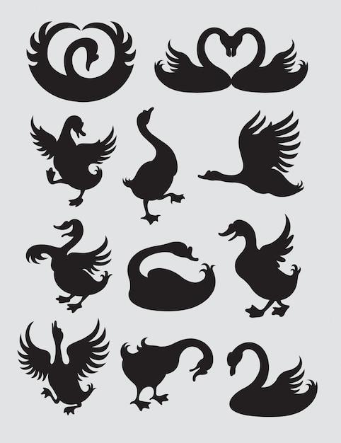 Duck and swan silhouette Vettore Premium
