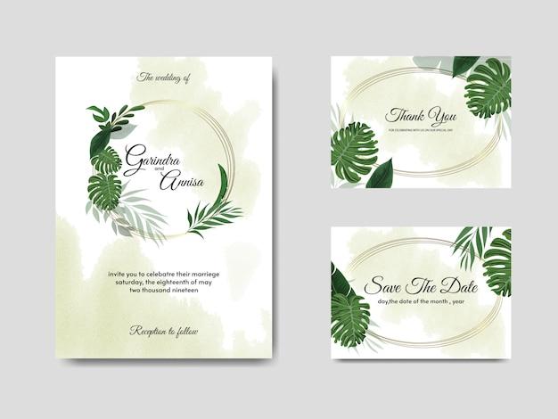 Modello di carta di invito matrimonio elegante con foglie tropicali Vettore Premium