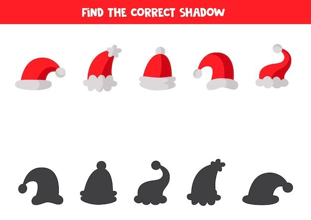 Trova le ombre corrette di ogni cappello di babbo natale. gioco logico educativo per bambini. Vettore Premium