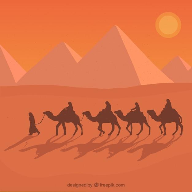 Le piramidi egiziane piane abbelliscono con la carovana dei cammelli Vettore Premium