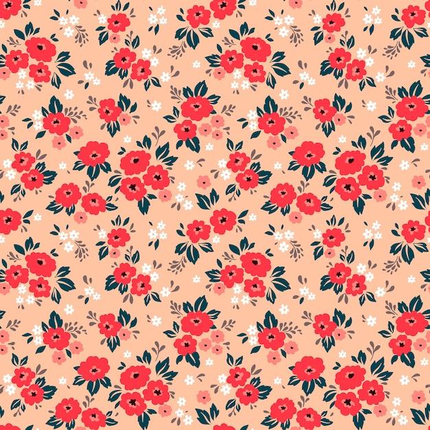 Motivo floreale. bei fiori, sfondo corallo. stampa con piccoli fiori rossi. stampa ditsy Vettore Premium