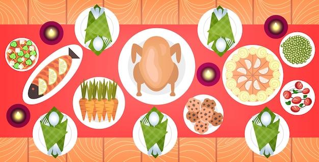 Cibo sul menu di natale o capodanno sul tavolo da pranzo anatra arrosto e contorni vacanza invernale celebrazione concetto vista dall'alto angolo illustrazione Vettore Premium