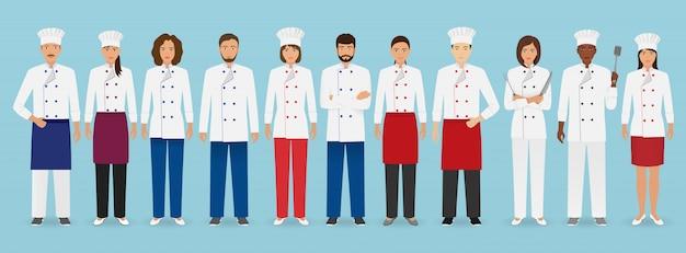 Squadra di occupazione del servizio di ristorazione in piedi in uniforme. gruppo di personaggi della ristorazione chef, cuoco, camerieri e barman. Vettore Premium