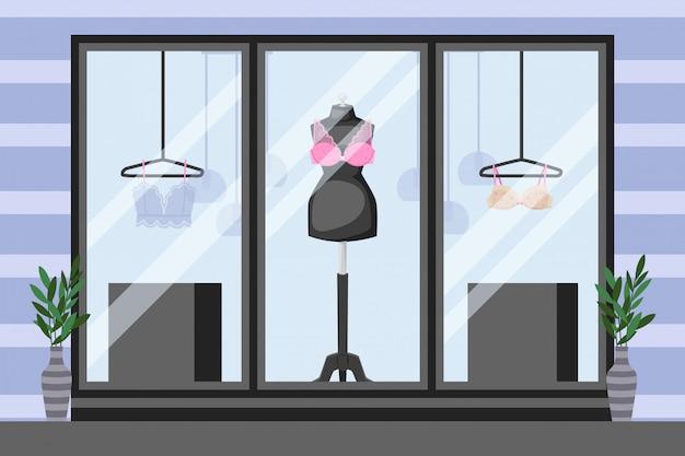 Vetrina frontale negozio di biancheria intima, illustrazione. manichino con reggiseno in pizzo, abiti sottili su gancio. vasi vicino a windows Vettore Premium