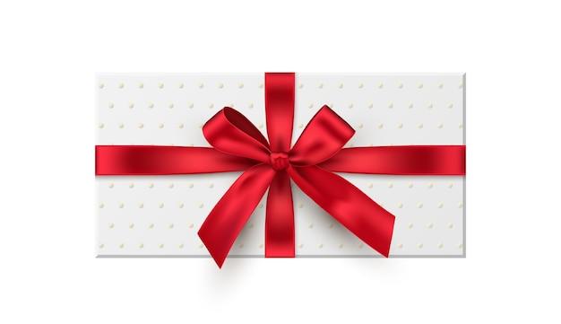 Confezione regalo, presente illustrazione realistica con fiocco in nastro rosso isolato su sfondo bianco Vettore Premium