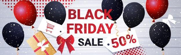 Scatole regalo con palloncini banner grande vendita venerdì nero Vettore Premium