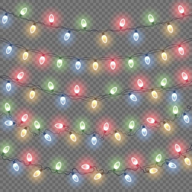 Incandescente luci di natale isolate. set di ghirlande colorate. Vettore Premium