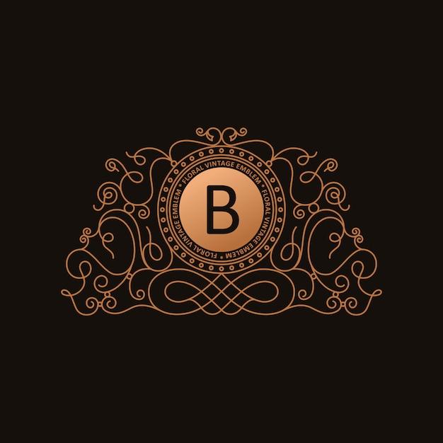 Logo calligrafico di lusso in oro Vettore Premium