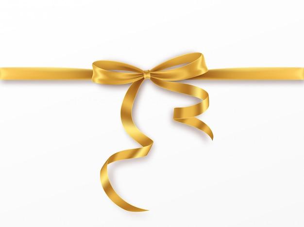 Arco e nastro dorati su fondo bianco. realistico fiocco d'oro. Vettore Premium