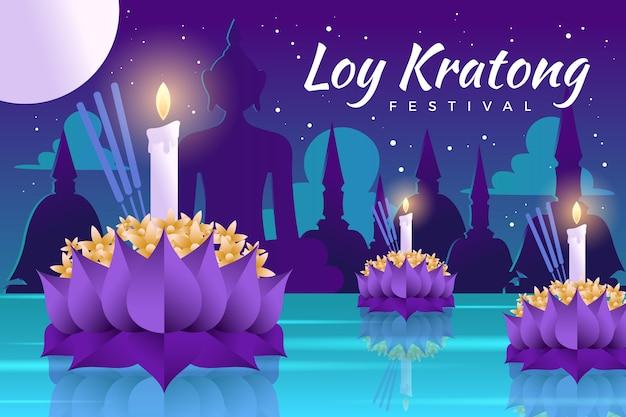 Fiore di loto krathong loy gradiente e candele nella notte Vettore Premium