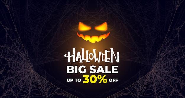 Banner di grande vendita di halloween. zucca incandescente. premium. Vettore Premium