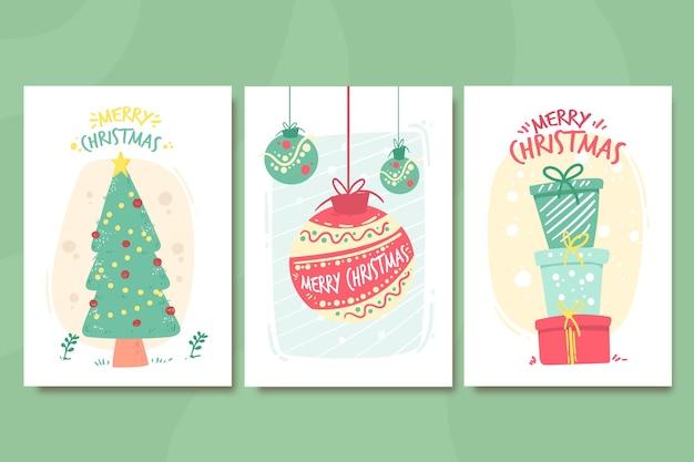 Collezione di cartoline di natale disegnate a mano Vettore Premium