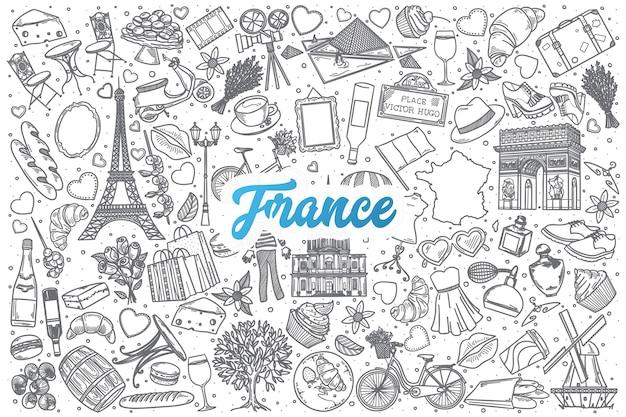 Fondo stabilito di doodle francia disegnato a mano con scritte blu Vettore Premium