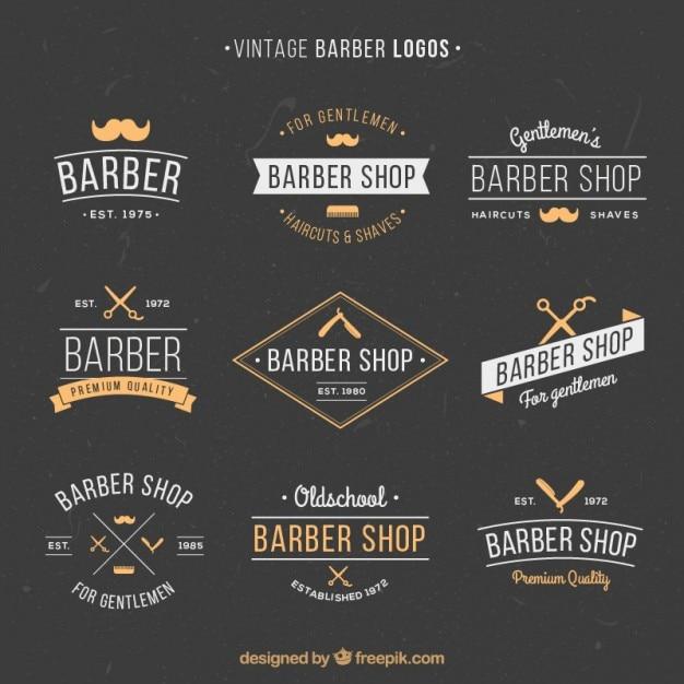 Disegnati a mano loghi annata barbiere Vettore Premium