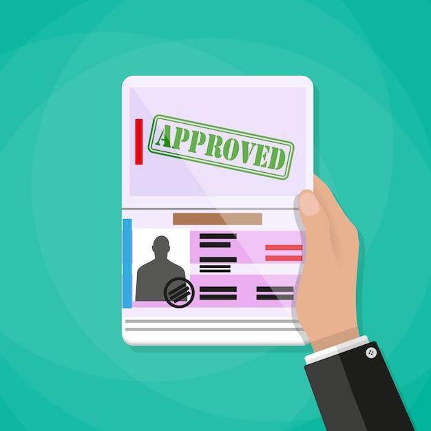 Passaporto internazionale della holding della mano Vettore Premium