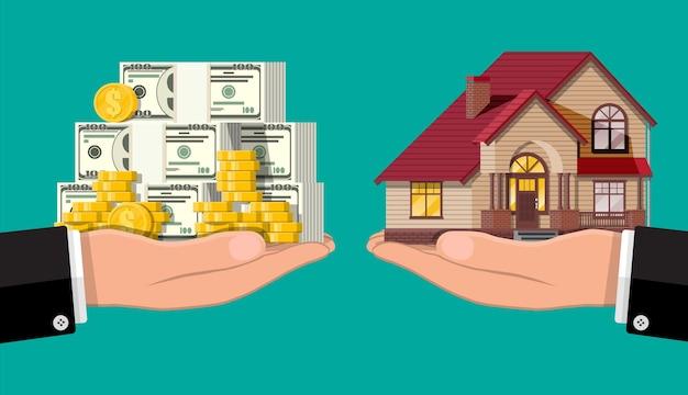 Bilancia a mano con casa privata e denaro. acquistare una casa. immobiliare. casa suburbana in legno, pile di dollari e monete d'oro. Vettore Premium