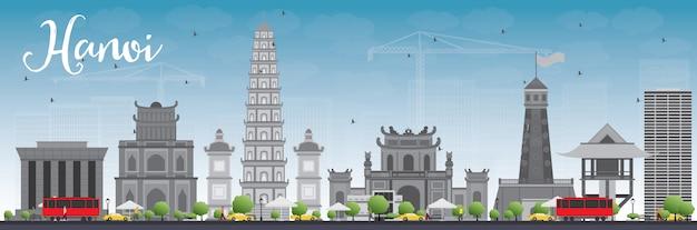Orizzonte di hanoi con punti di riferimento e cielo blu grigi. Vettore Premium