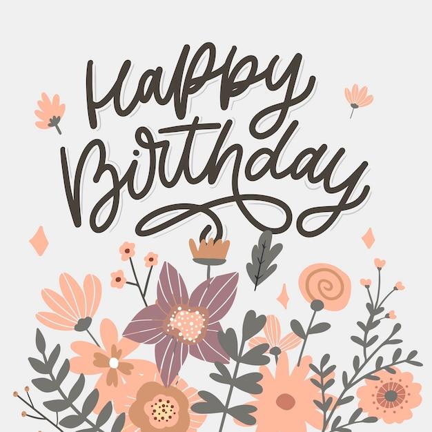 Buon compleanno lettering slogan di calligrafia con fiori Vettore Premium
