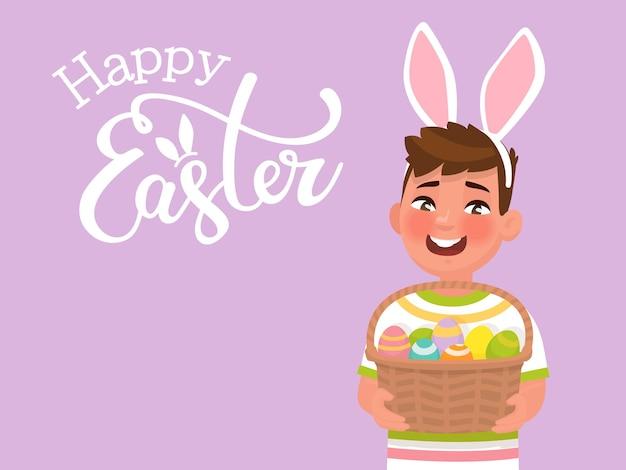 Buona pasqua con la scritta e un ragazzo con orecchie di coniglio che tiene in mano un cesto con le uova. modello per congratulazioni per la vacanza. in stile cartone animato Vettore Premium