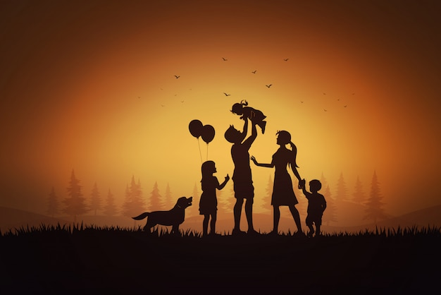 Il giorno della famiglia felice, madre del padre e siluetta dei bambini che giocano sull'erba nel tramonto. Vettore Premium