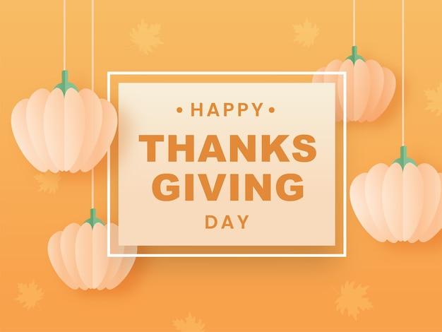 Felice giorno del ringraziamento testo su sfondo arancione chiaro decorato con zucche di carta appese. Vettore Premium