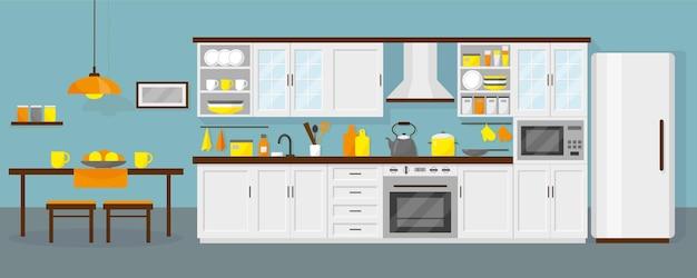 Interiore della cucina con mobili, frigorifero, microonde, tavola e stoviglie. sfondo blu. Vettore Premium