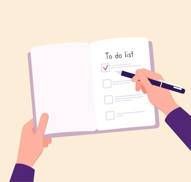 Per elencare il concetto. elenco di controllo delle note di scrittura delle mani sul tavolo. concetto di piano aziendale completo Vettore Premium