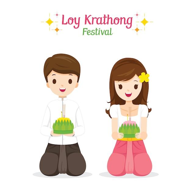 Festival di loy krathong, ragazzo e ragazza in abiti tradizionali tailandesi, costume nazionale, celebrazione e cultura della thailandia Vettore Premium