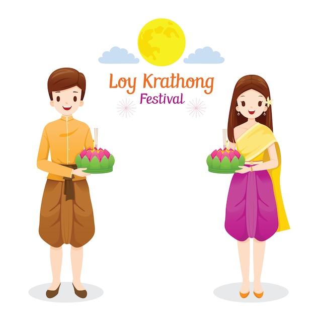 Loy krathong festival, coppia in abiti tradizionali tailandesi, costume nazionale in piedi, celebrazione e cultura della thailandia Vettore Premium