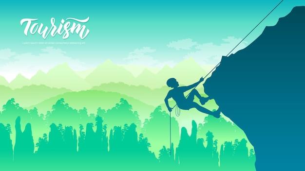 Un uomo si arrampica su una roccia, una montagna al tramonto Vettore Premium