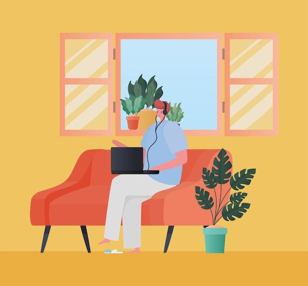 Uomo con il computer portatile che lavora sul design divano arancione del tema del lavoro da casa Vettore Premium