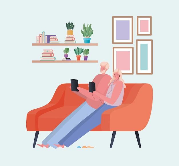 Uomo e donna con tavoletta lavorando sul design divano arancione del tema del lavoro da casa Vettore Premium