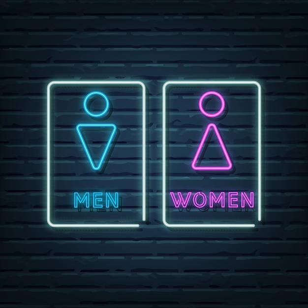 Elementi dell'insegna al neon del bagno di uomini e donne Vettore Premium