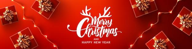 Buon natale e felice anno nuovo poster promozionale o banner con confezione regalo rossa e luci a led Vettore Premium