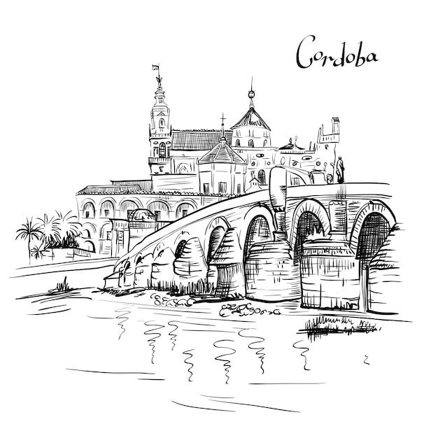 Moschea e ponte romano a cordoba, spagna Vettore Premium
