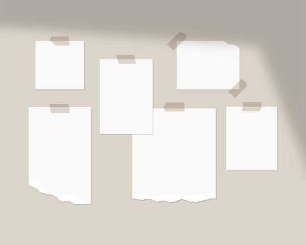Modello di mood board. fogli vuoti di carta bianca sul muro con sovrapposizione di ombre. isolato. progettazione del modello. illustrazione realistica. Vettore Premium