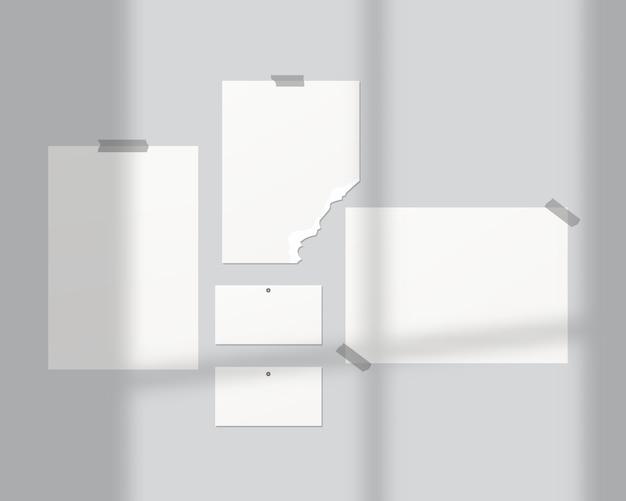 Tavole d'umore . fogli vuoti di carta bianca sul muro. mood board con sovrapposizione di ombre. . modello di progettazione. illustrazione realistica di vettore Vettore Premium