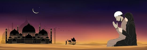 Siluetta della moschea con uomo e donna musulmani che fanno una supplica sul deserto Vettore Premium